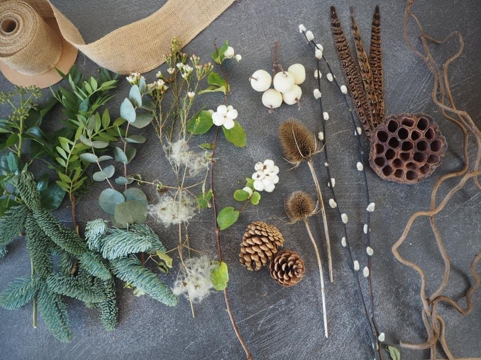 Evergreen foliage and natural decorations laid on a table
